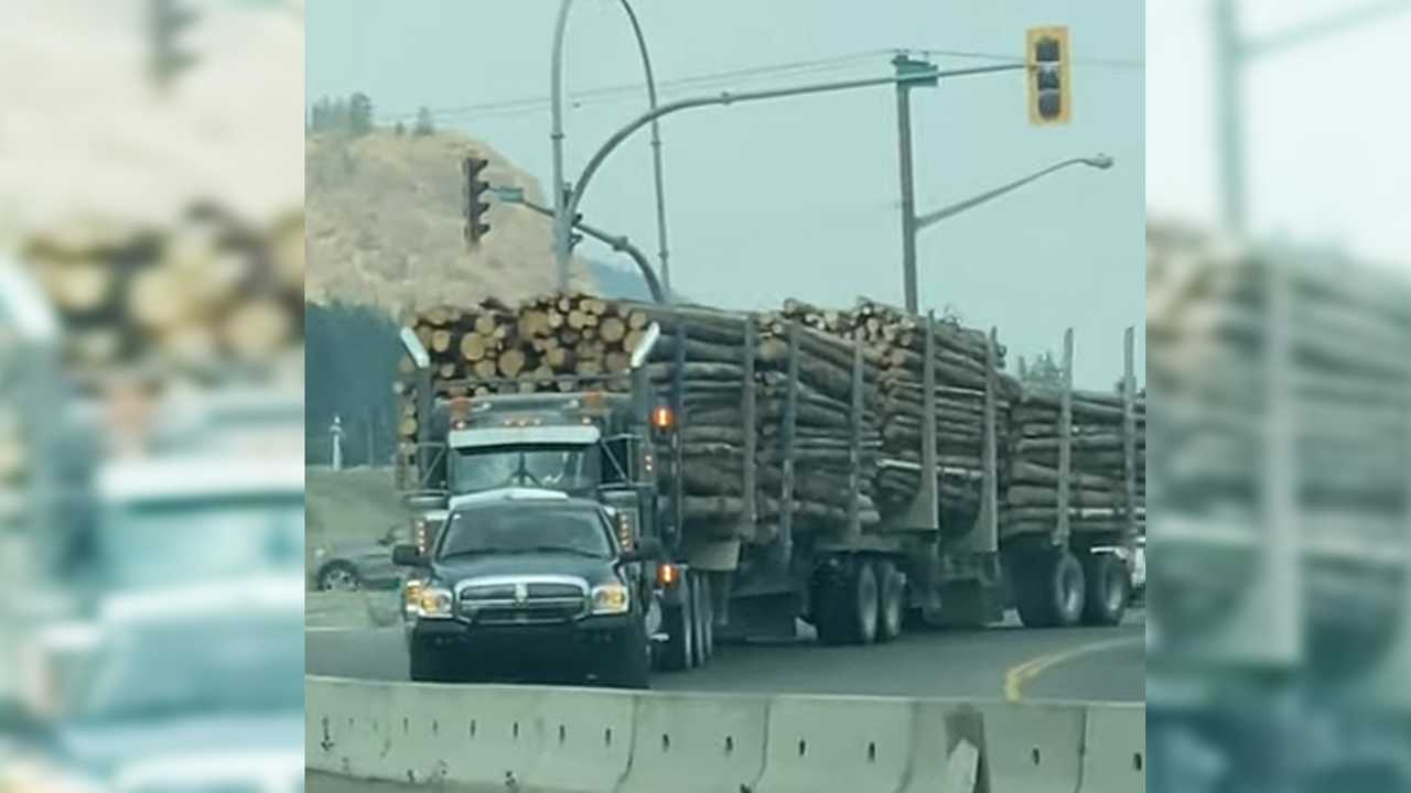 Ram Truck Tows Logging Rig