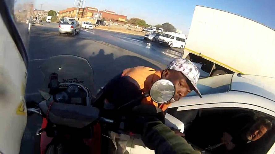 Watch This Motorcyclist Run Down a Carjacker