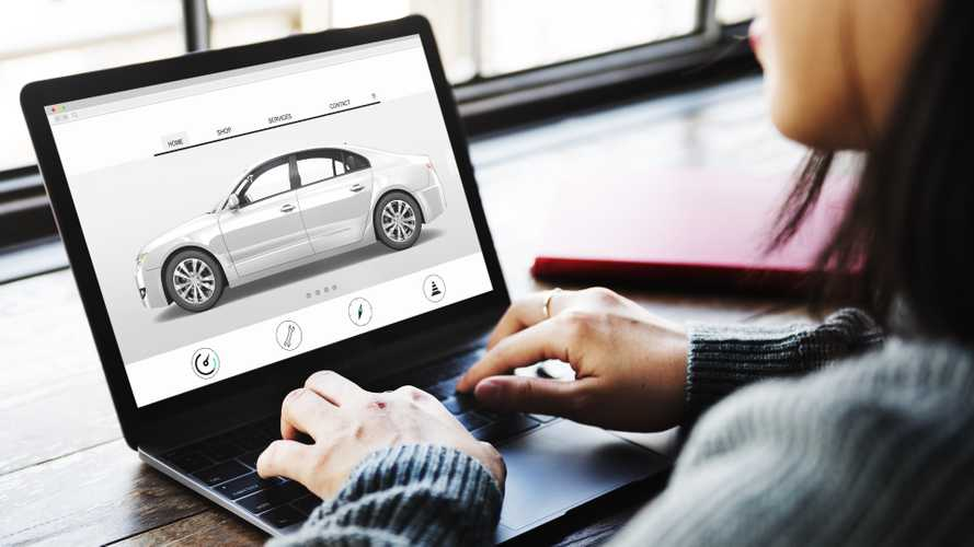 Woman researching cars on internet using laptop