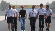 Michael Schumacher (GER) with Ross Brawn (GBR) Team Principal, Mercedes GP Petronas and Andrew Shovlin (GBR), Senior Race Engineer to Michael Schumacher walking the track - Formula 1 World Championship, Rd 17, Korean Grand Prix, 21.10.2010 Yeongam, Korea