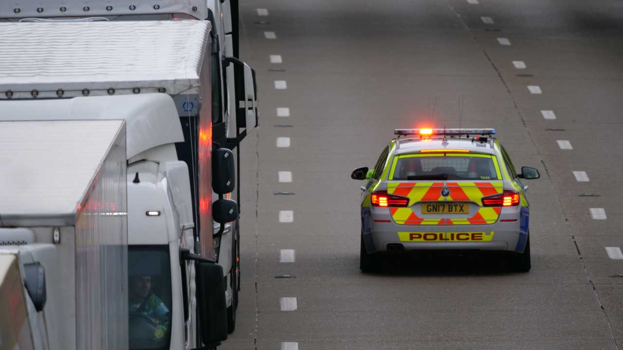 Police on M20 motorway in Kent during Dover Port traffic delays during Storm Gareth