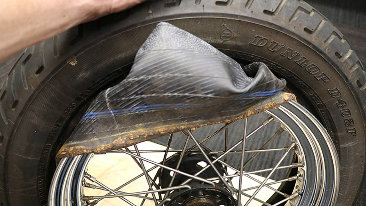 <em>Tubes are relatively cheap, so replacing them along with the tire is always a good practice. This one is loaded with rust from the rim, so it is going straight into the trash.</em>