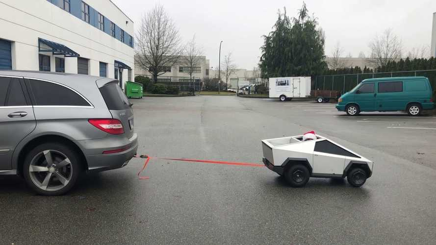 Watch mini Tesla Cybertruck win in tug-of-war against Mercedes R-Class