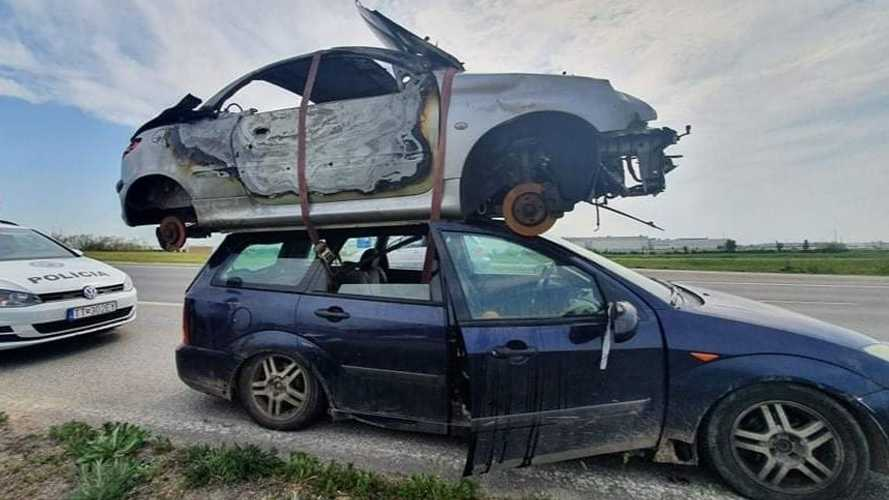 Ford Focus pulled over for carrying Peugeot 206 CC on its roof