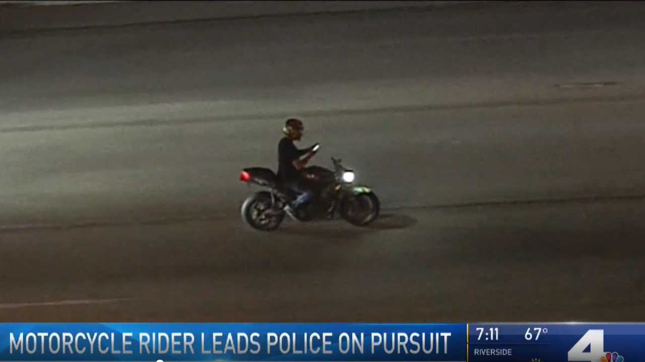 Moto Rider On His Phone During Police Chase