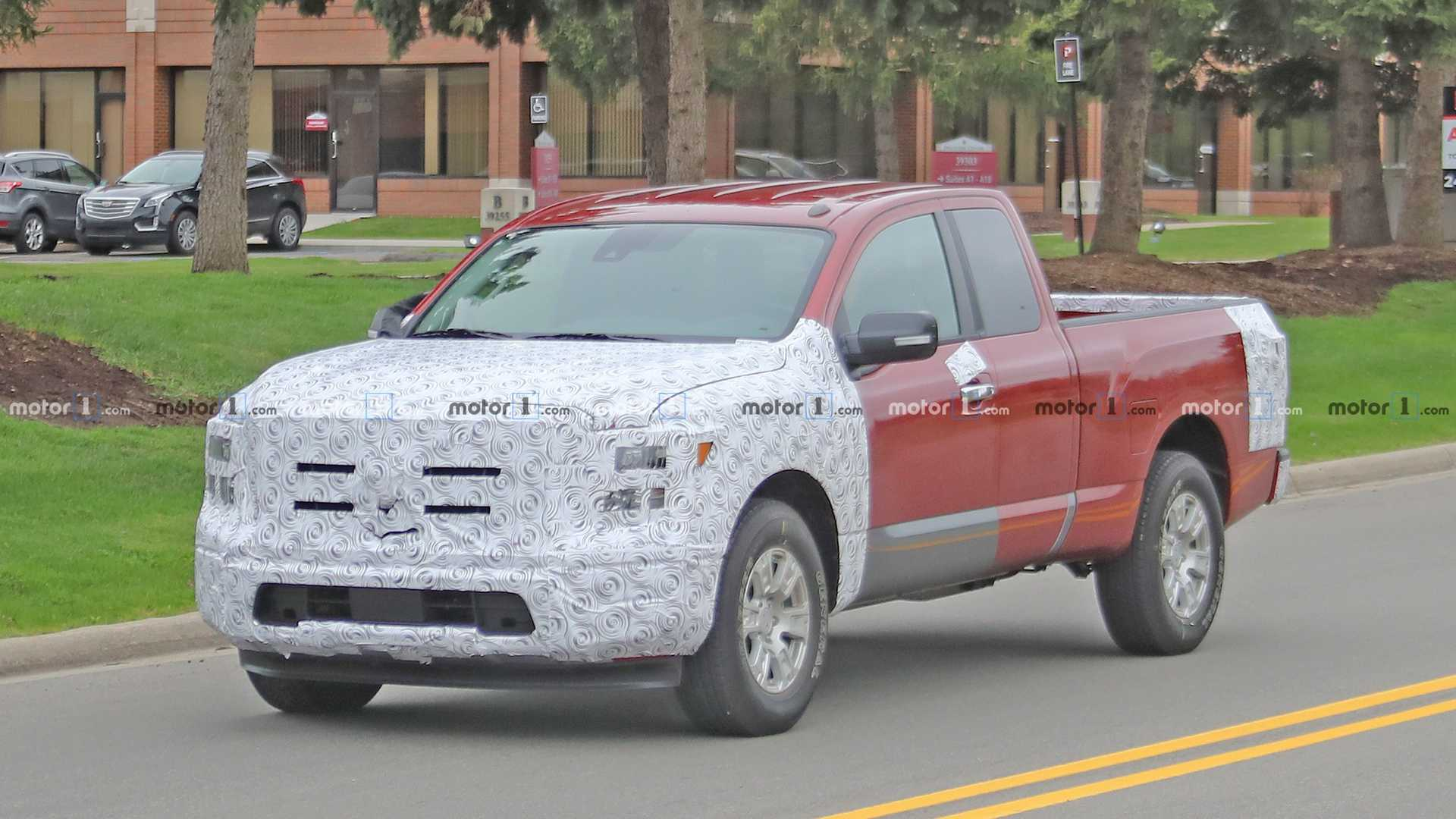 Nissan Titan Facelift Spied For First Time Disguised As An F 150
