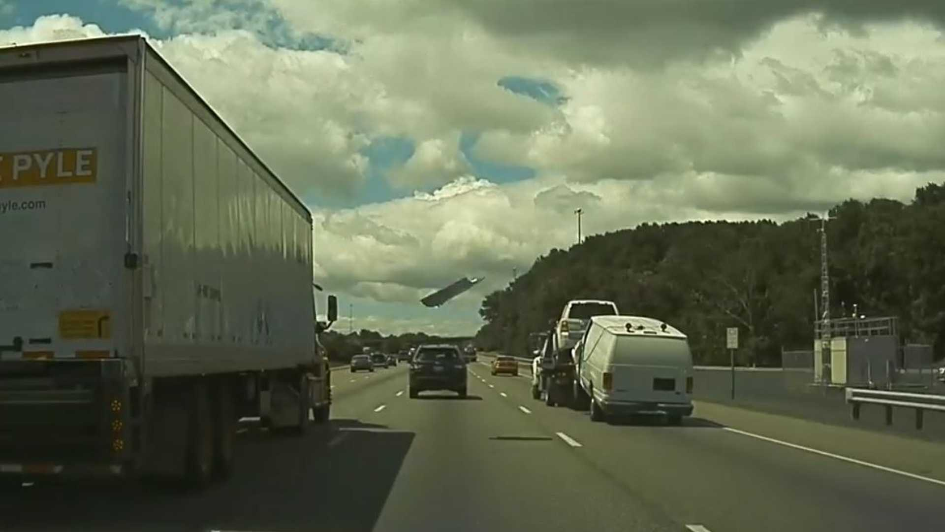 Tesla Dashcam Captures Unsafe Towing, Flying Debris Hits Semi: Video