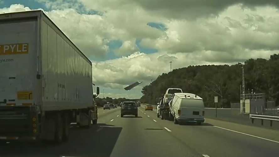 Tesla Dashcam Captures Unsafe Towing, Flying Debris Hits Semi: Video