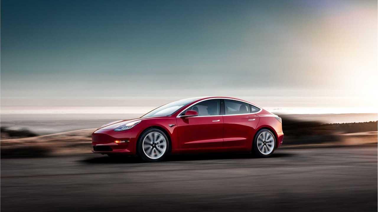 Tesla Model 3 driving red
