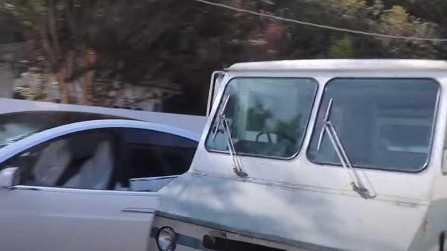 Watch Borat Crash Mail Truck Into Tesla Model X Door For Laughs