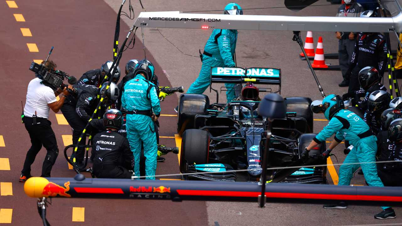 Valtteri Bottas, Mercedes W12, in the pits with technical issues relating to his front right wheel
