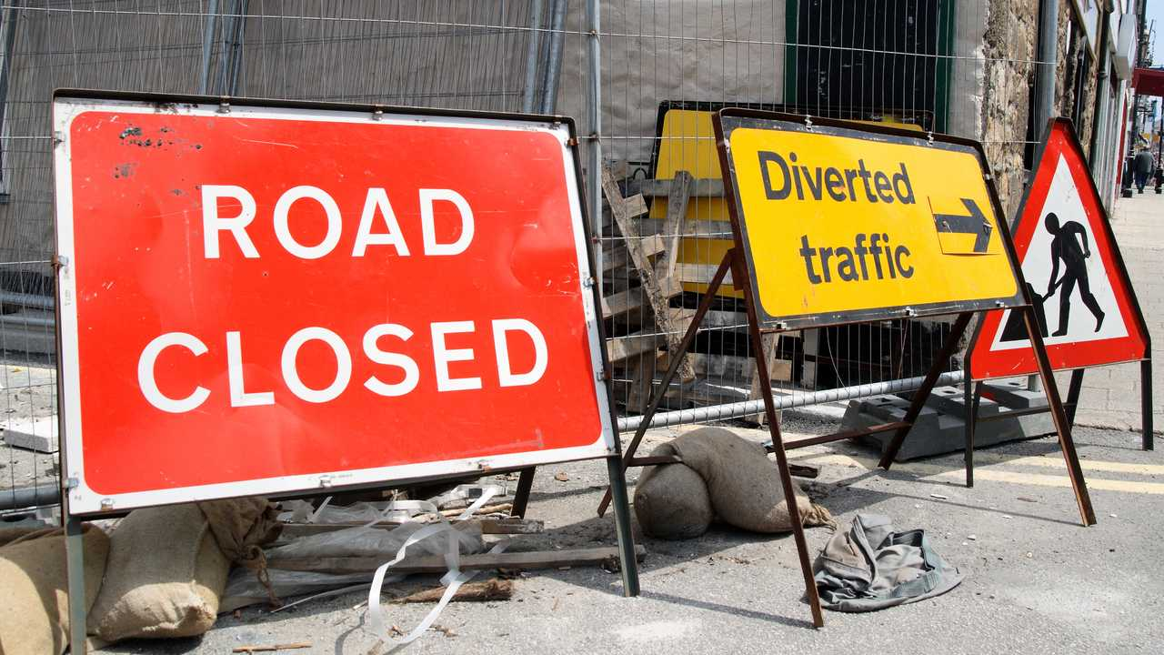 British roadworks with road closed and diverted traffic signs