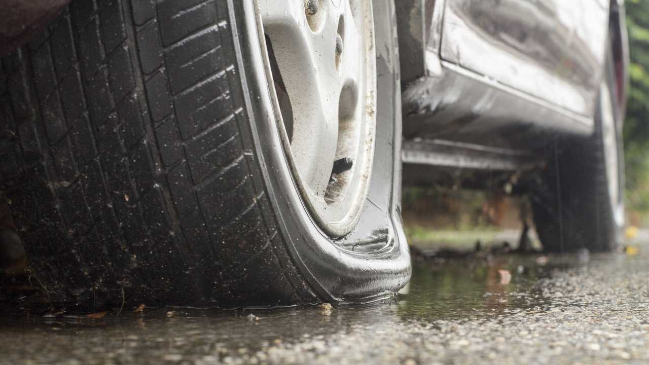 Car flat tyre in rainy day
