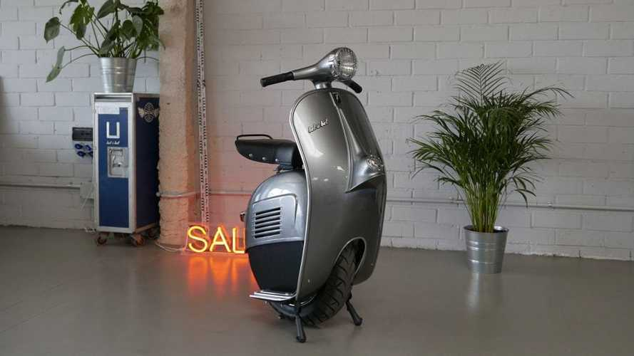This Quirky Vespa-Inspired Scooter Is Missing A Wheel
