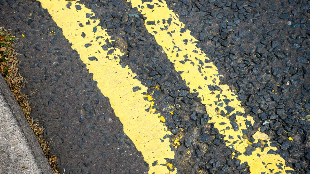 Yellow lines on a tarmac road