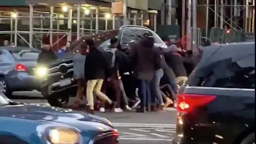 Bystanders lift Mercedes SUV off trapped pedestrian in NYC