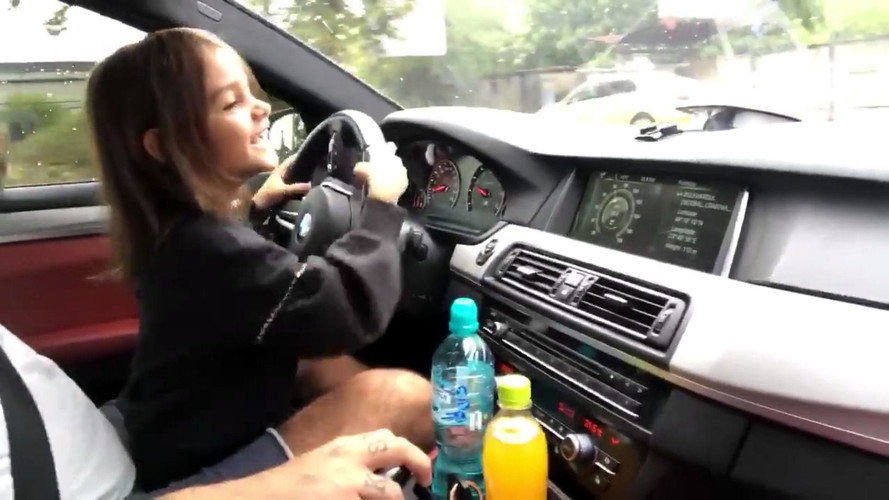 Watch A Little Girl Infectiously Laugh While Driving A BMW M5