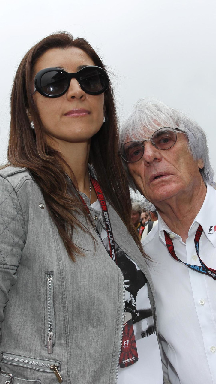 Bernie Ecclestone (GBR) with his wife Fabiana Flosi (BRA) / XPB