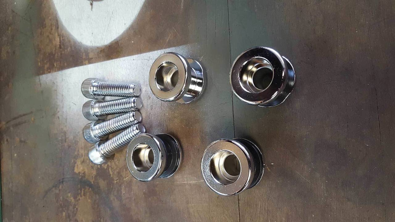 Four little knobs and their bolts. An easy job.