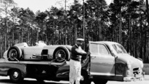 """Hockenheimring, 1955. Juan Manuel Fangio and """"The Blue Wonder"""" racing car carrier from Mercedes-Benz with a W 196 R Formula 1 racing car"""