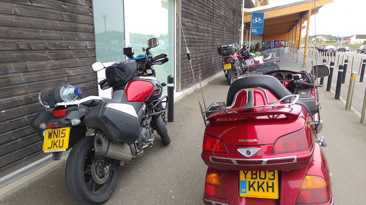 My 'Strom among the bikes parked outside Wick's Tesco grocery store.