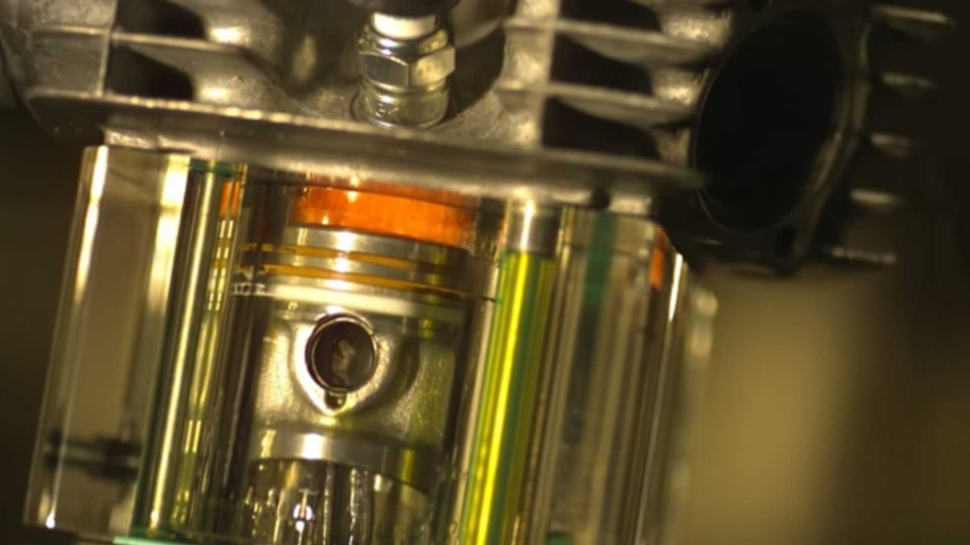 Slo-mo footage of running engine with clear cylinder is mesmerising
