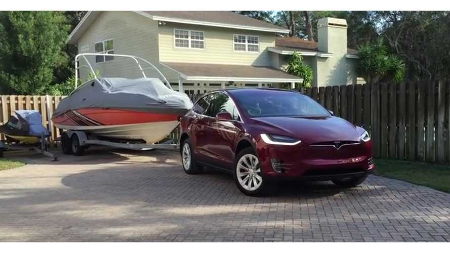 Tesla Model X and boat