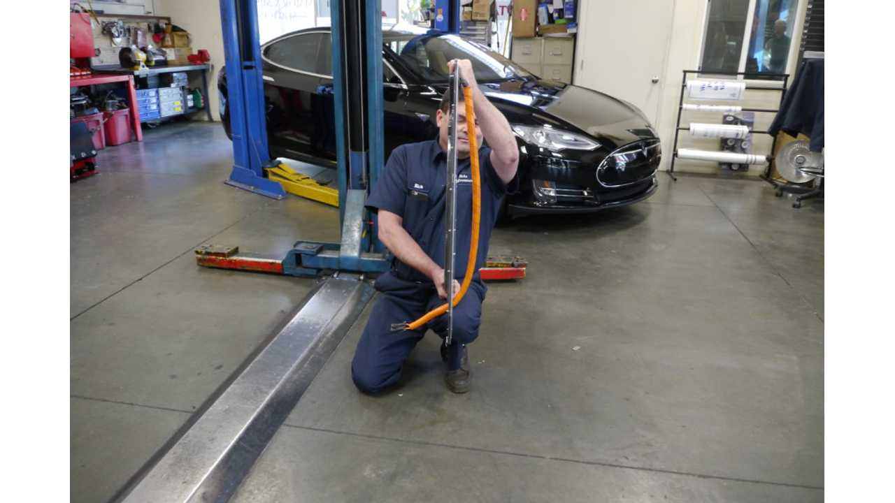 Rick shows off the ultra-thin receiving coil that will allow his Tesla to receive wireless charging.