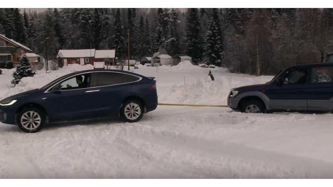 Tesla Model X Pulls Land Cruiser Out Of Snow & Vice Versa - Videos