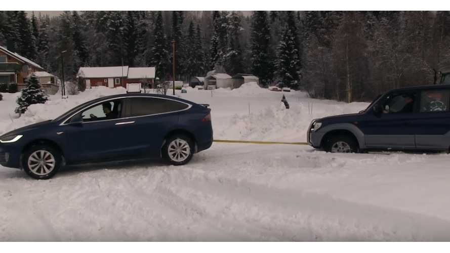 Tesla Model X Pulls Land Cruiser Out Of Snow & Vice Versa - Videos