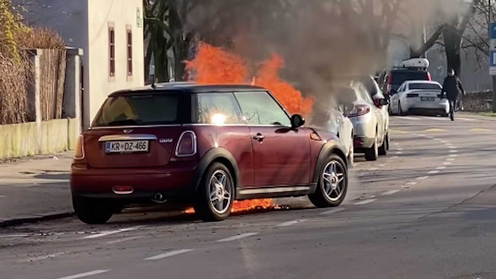 Watch a fire cause a Mini's engine to start on it own, ram parked cars