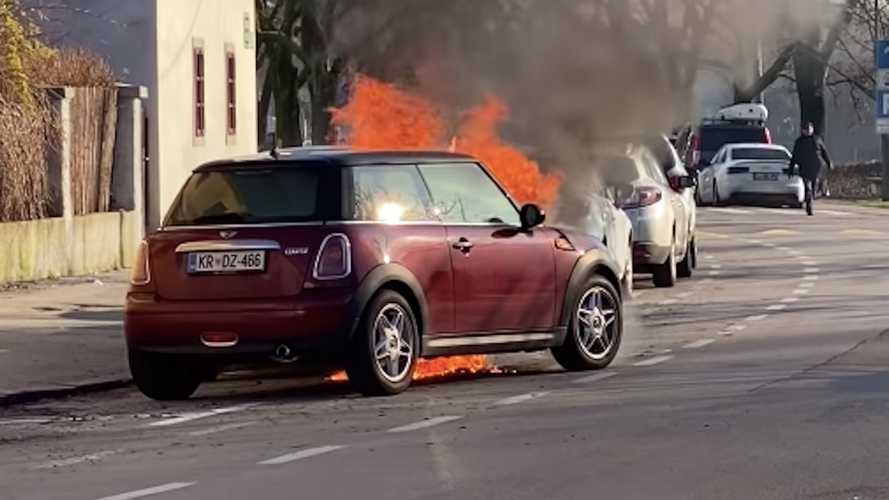 Watch a fire cause a Mini's engine to start, ram parked car