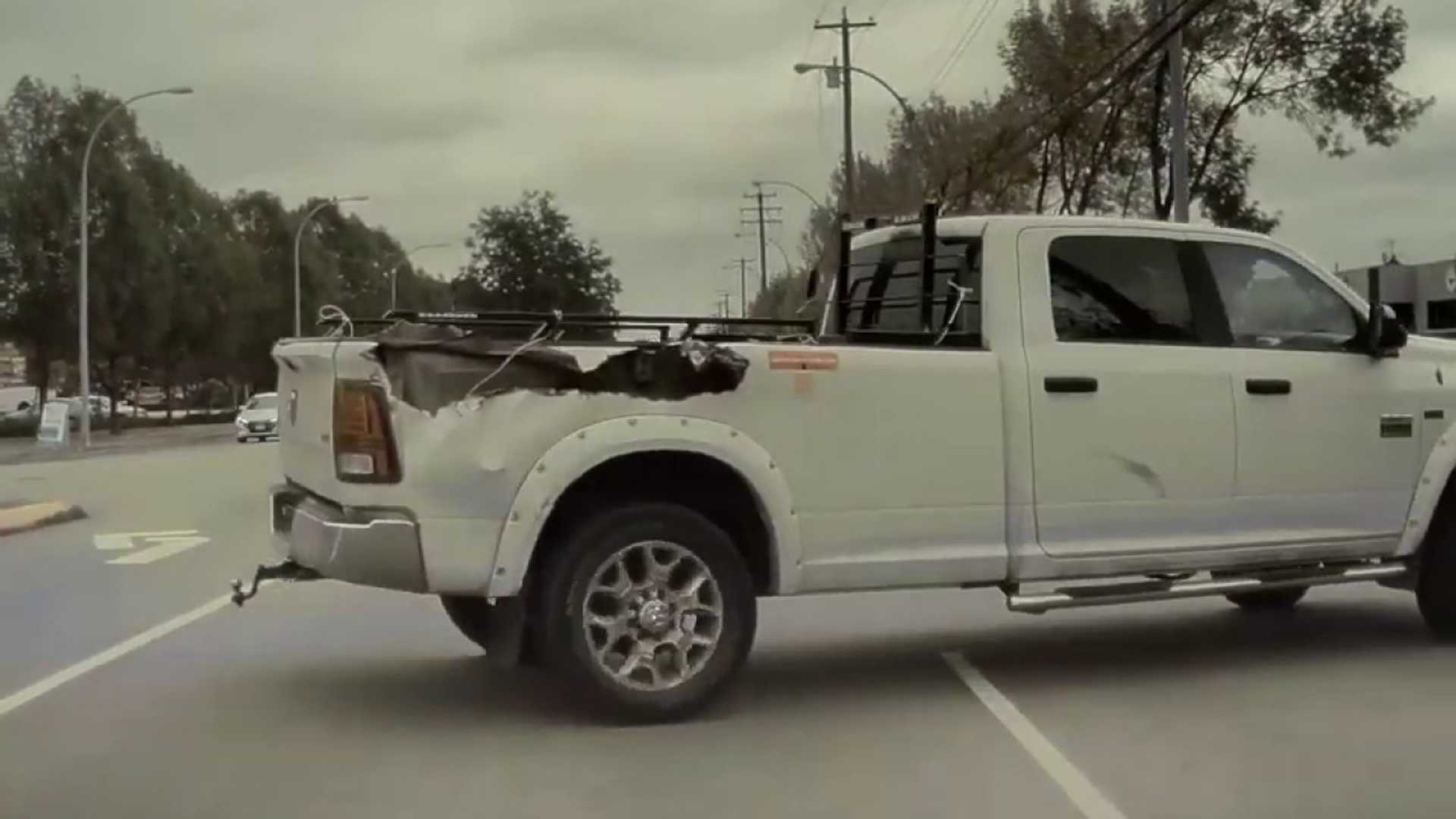 Watch Crazy Pickup Truck Driver Jump Median And Cut Off A Tesla