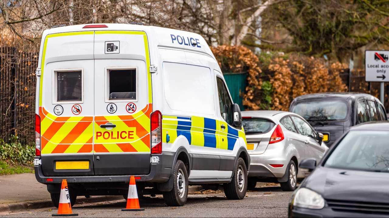 Police speed camera van on city road in UK