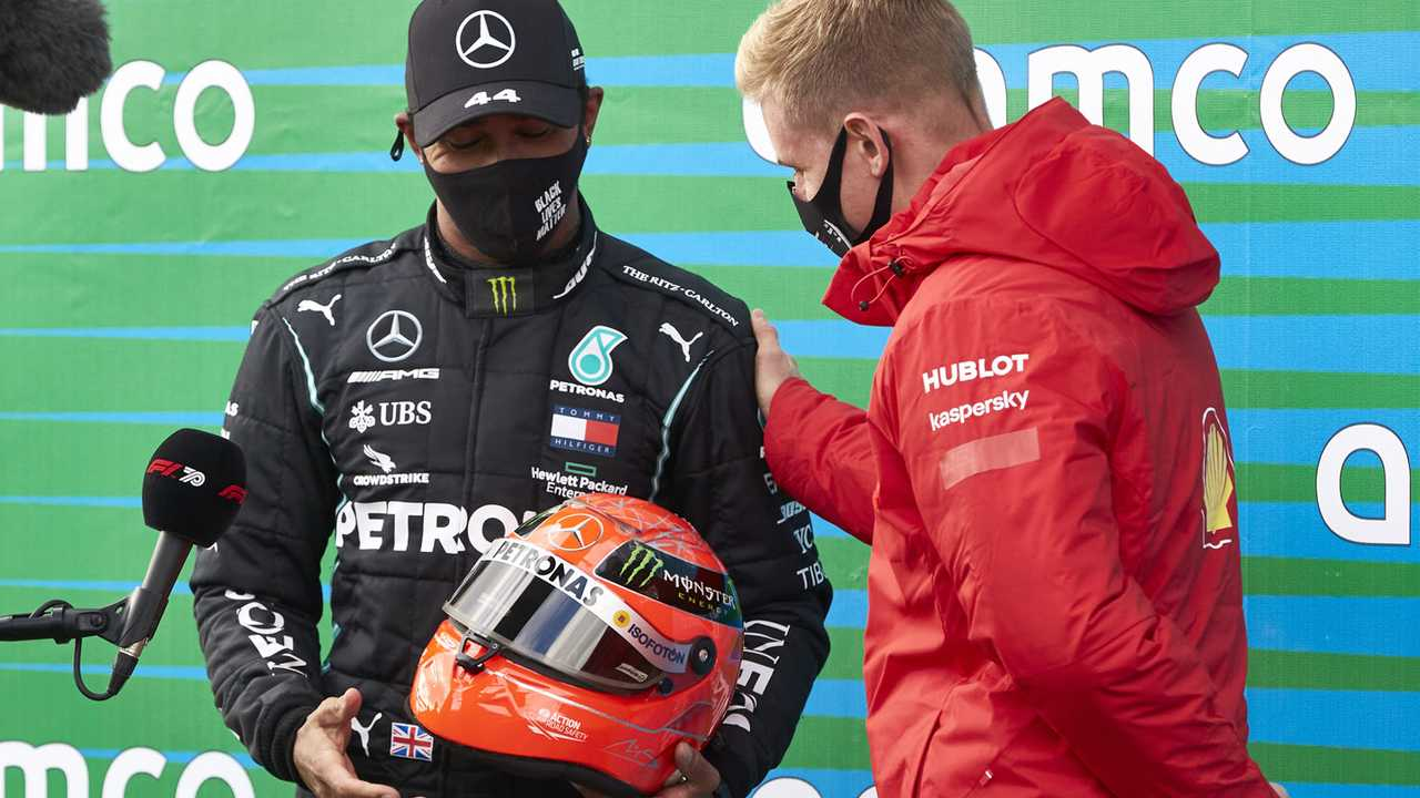 Mick Schumacher presents Lewis Hamilton, Mercedes-AMG F1, 1st position, with his fathers helmet after the Mercedes driver equalled Michael Schumachers record 91 race wins