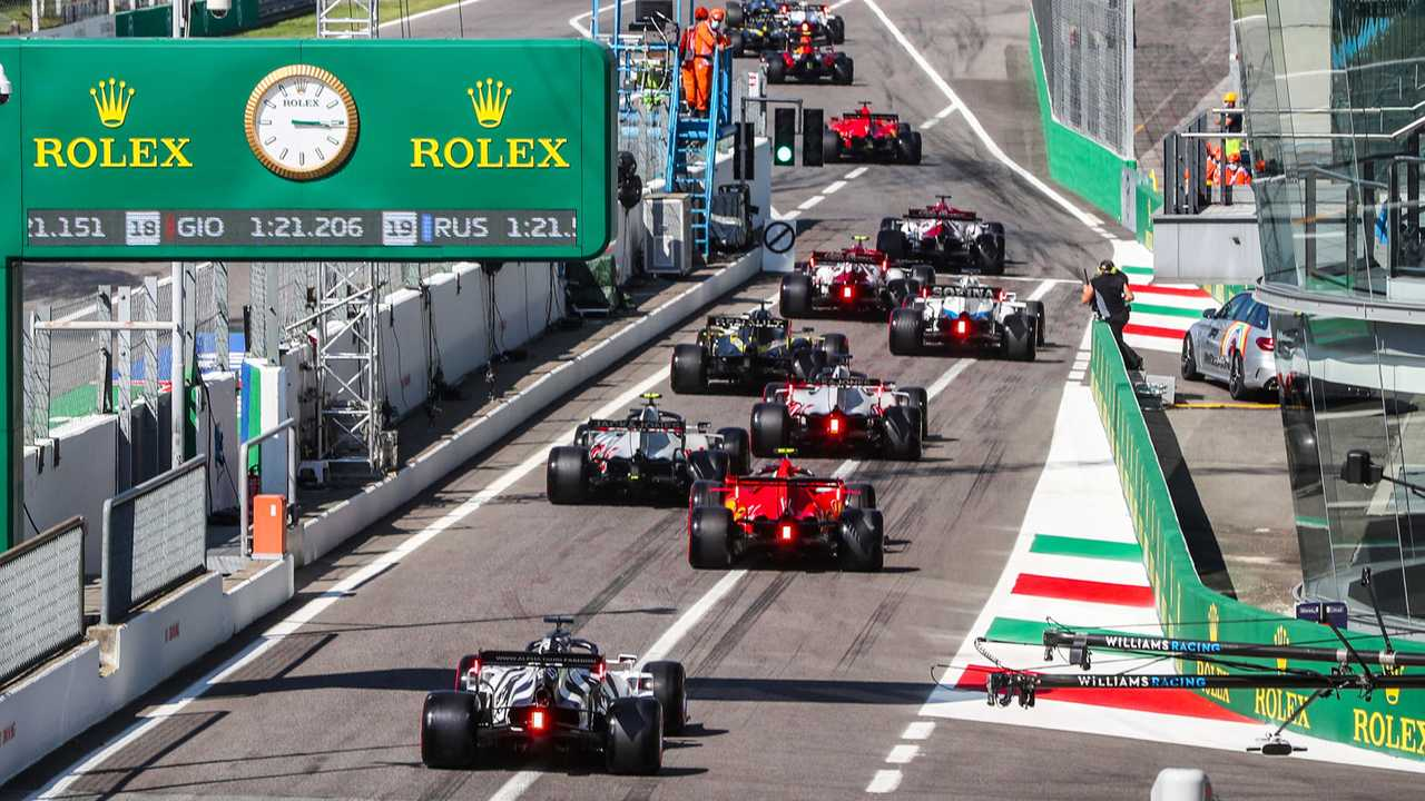 The drivers all head for the track at the start of Q1