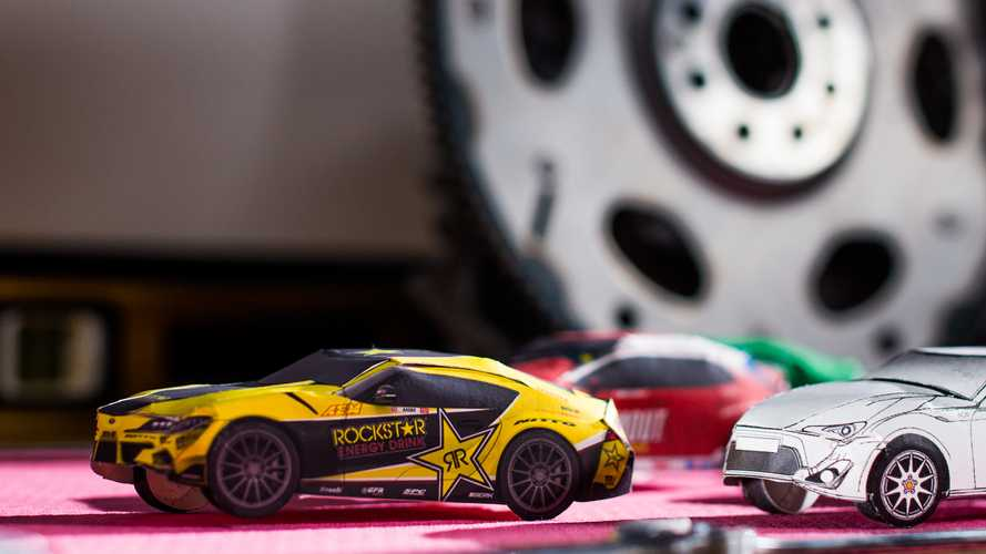 Watch A Toyota Supra Papercraft Model Drift Around A Race Shop