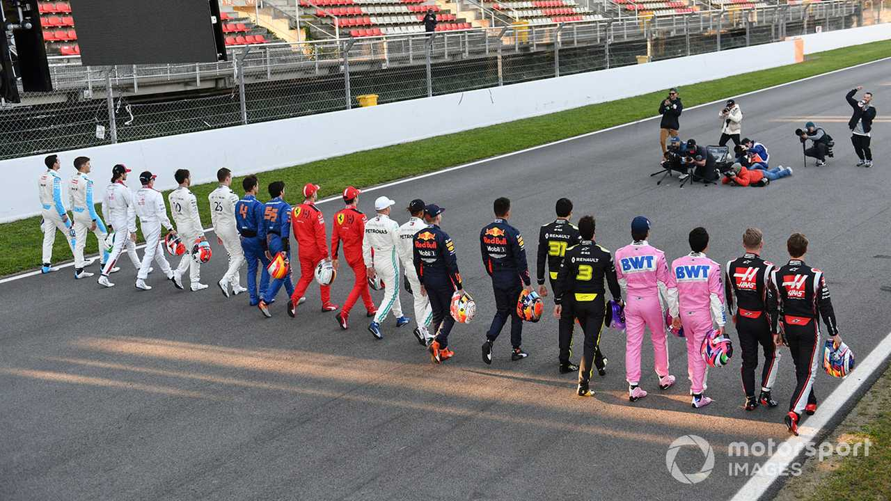 F1 drivers walk along the track in Barcelona 2020