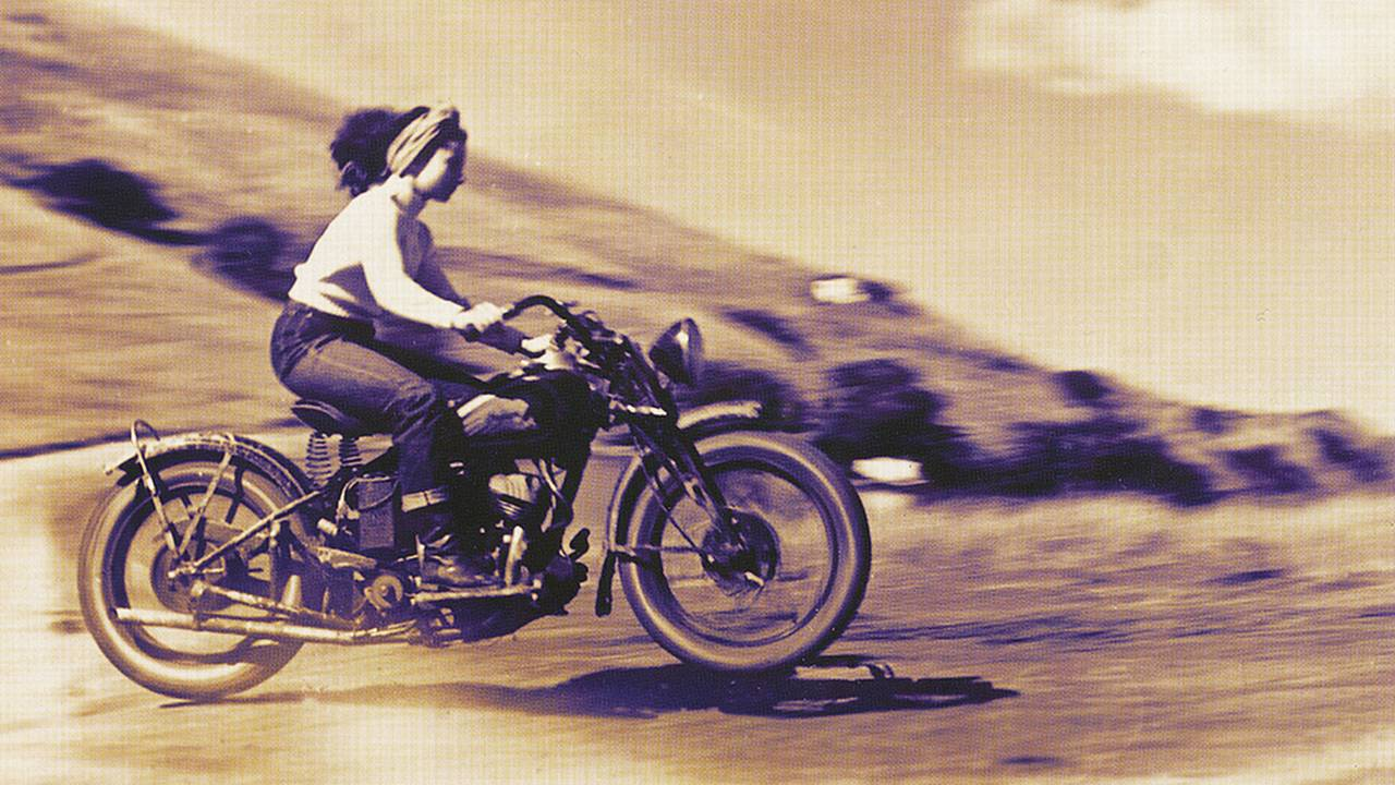 <strong>Racing along on an Indian wearing all the necessary protective gear of the era: A headband and boots...</strong>
