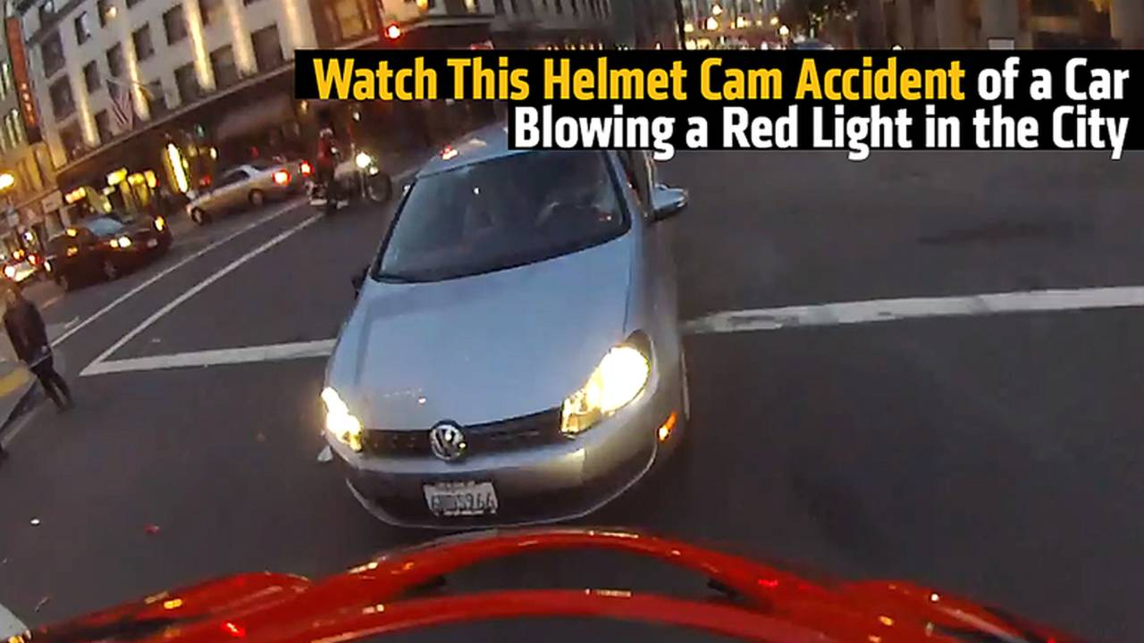 Watch This Helmet Cam Collision of a Car Blowing a Red Light in the City