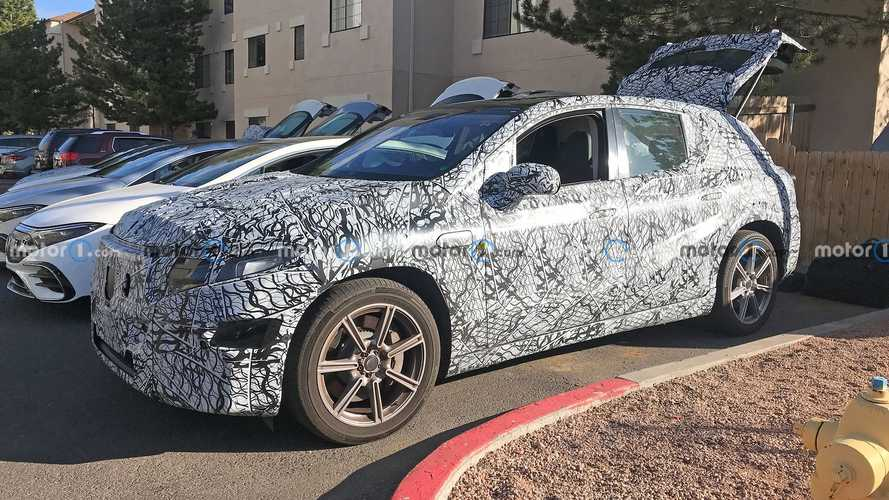 Mercedes EQS SUV spied in car park with its insides showing