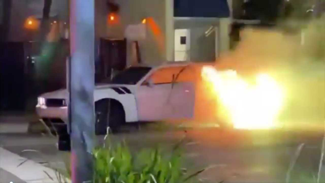 Video shows Dodge Challenger on fire in Miami.