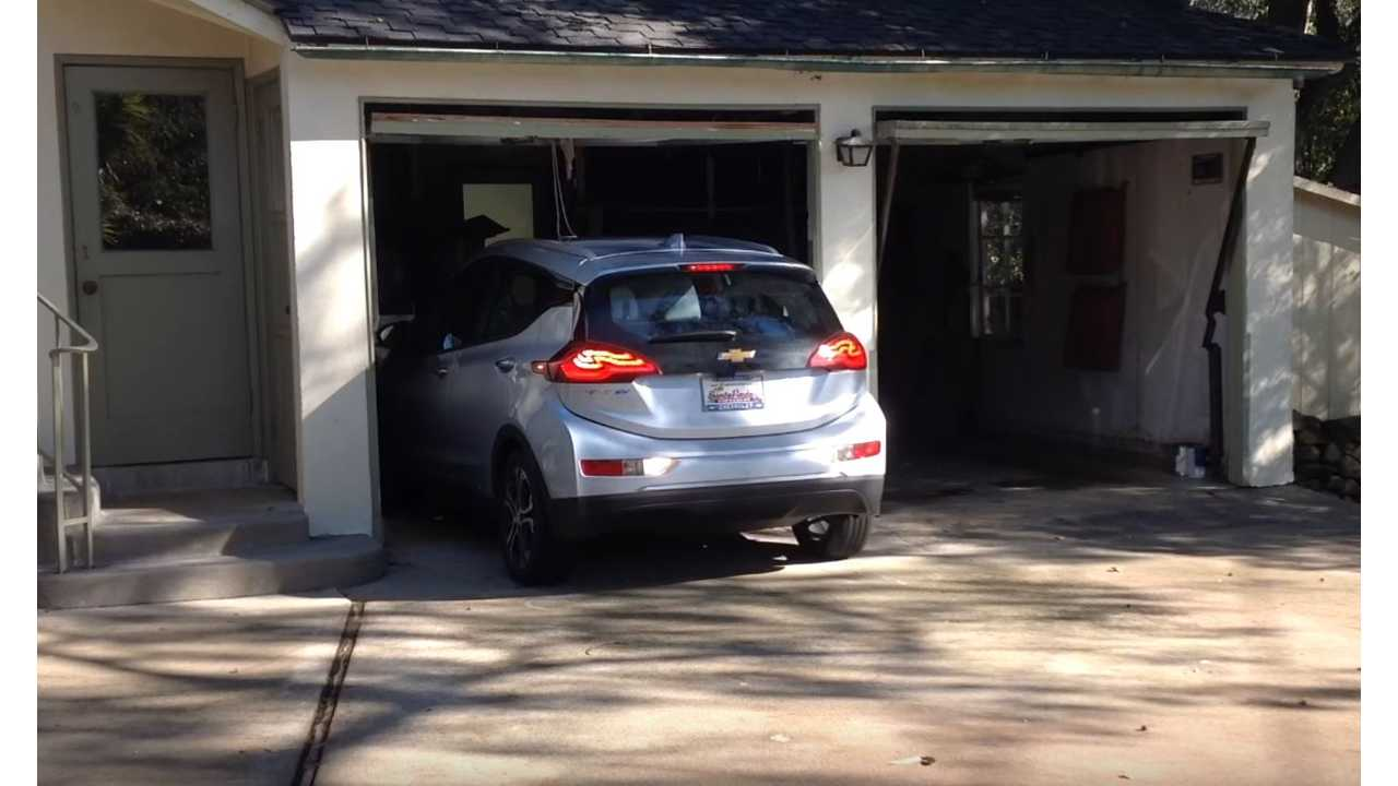 The Chevrolet Bolt is the perfect sized car for this old garage