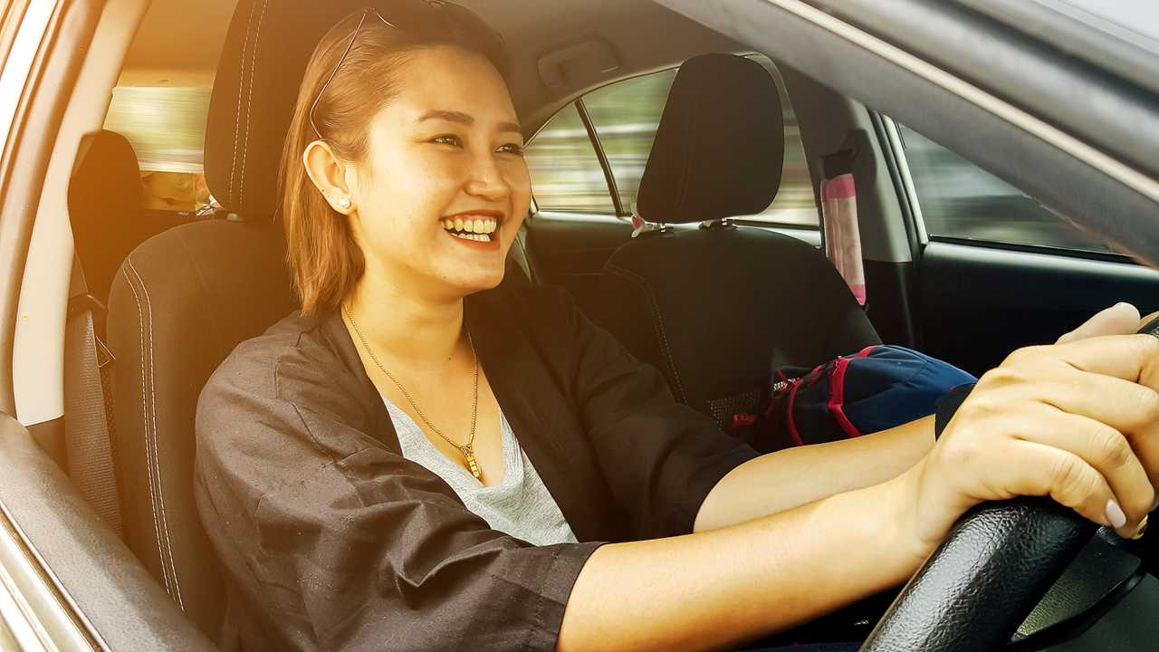 Woman driving a car while not wearing seatbelt