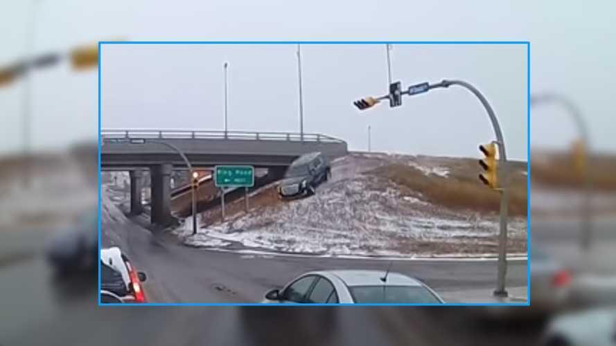 Cadillac Escalade Careens Off Embankment In Crazy Crash Video