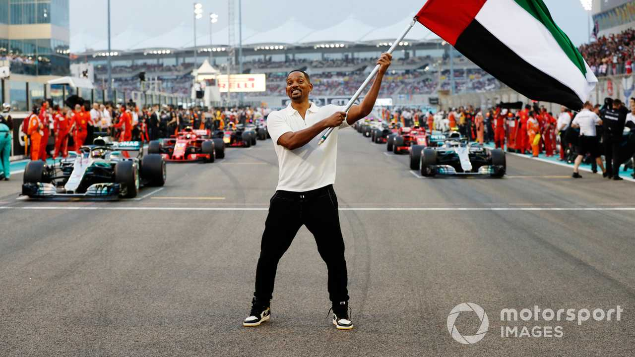 Actor Will Smith waves the UAE flag at Abu Dhabi GP 2018