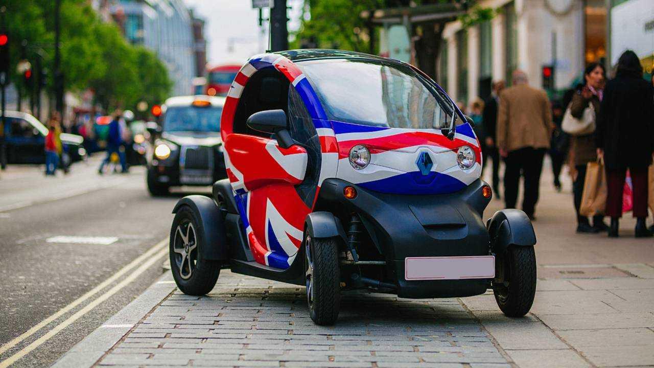 Renault Twizzy EV with Union Jack flag on Oxford Street