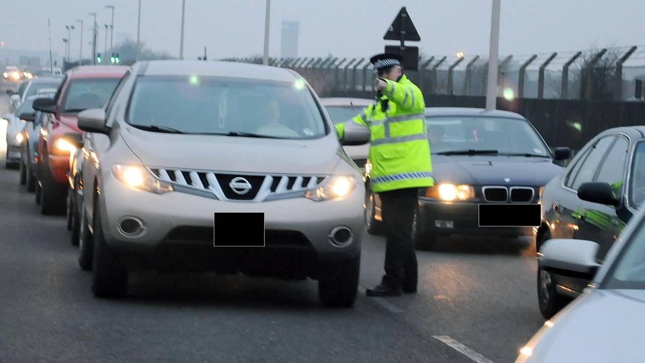 Police instructing driver in traffic