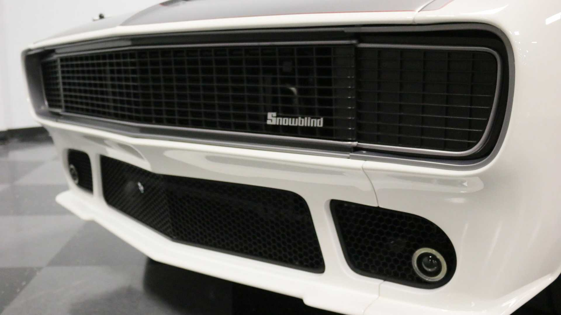 "[""Own This SEMA-Built '67 Chevy Camaro 'Snowblind' Restomod""]"