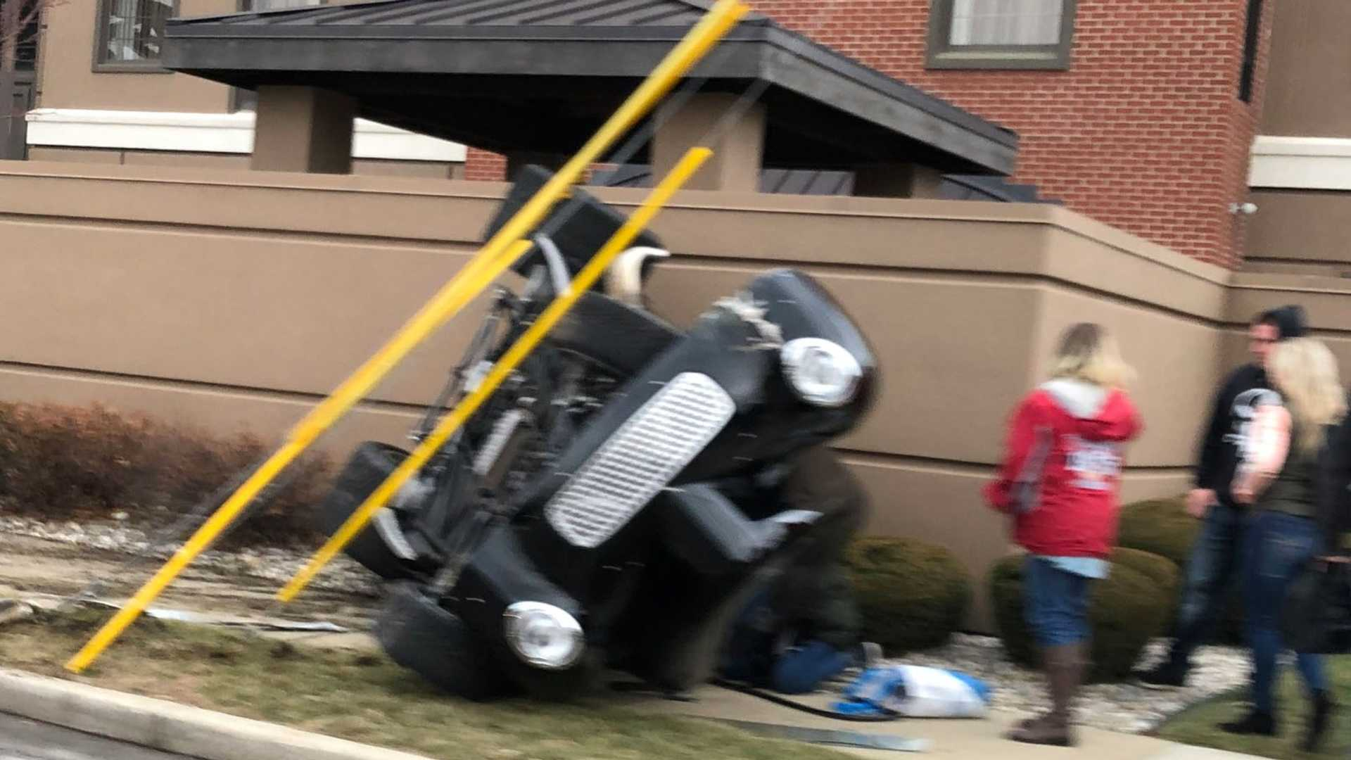 "[""Show-Off Driver Flips '40s Willys Coupe While Leaving PRI Show""]"